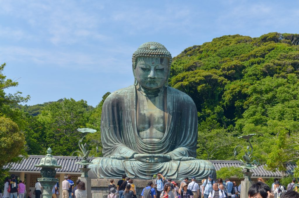 Kamakura's famous Buddha statue is worth visiting during your two weeks in Japan